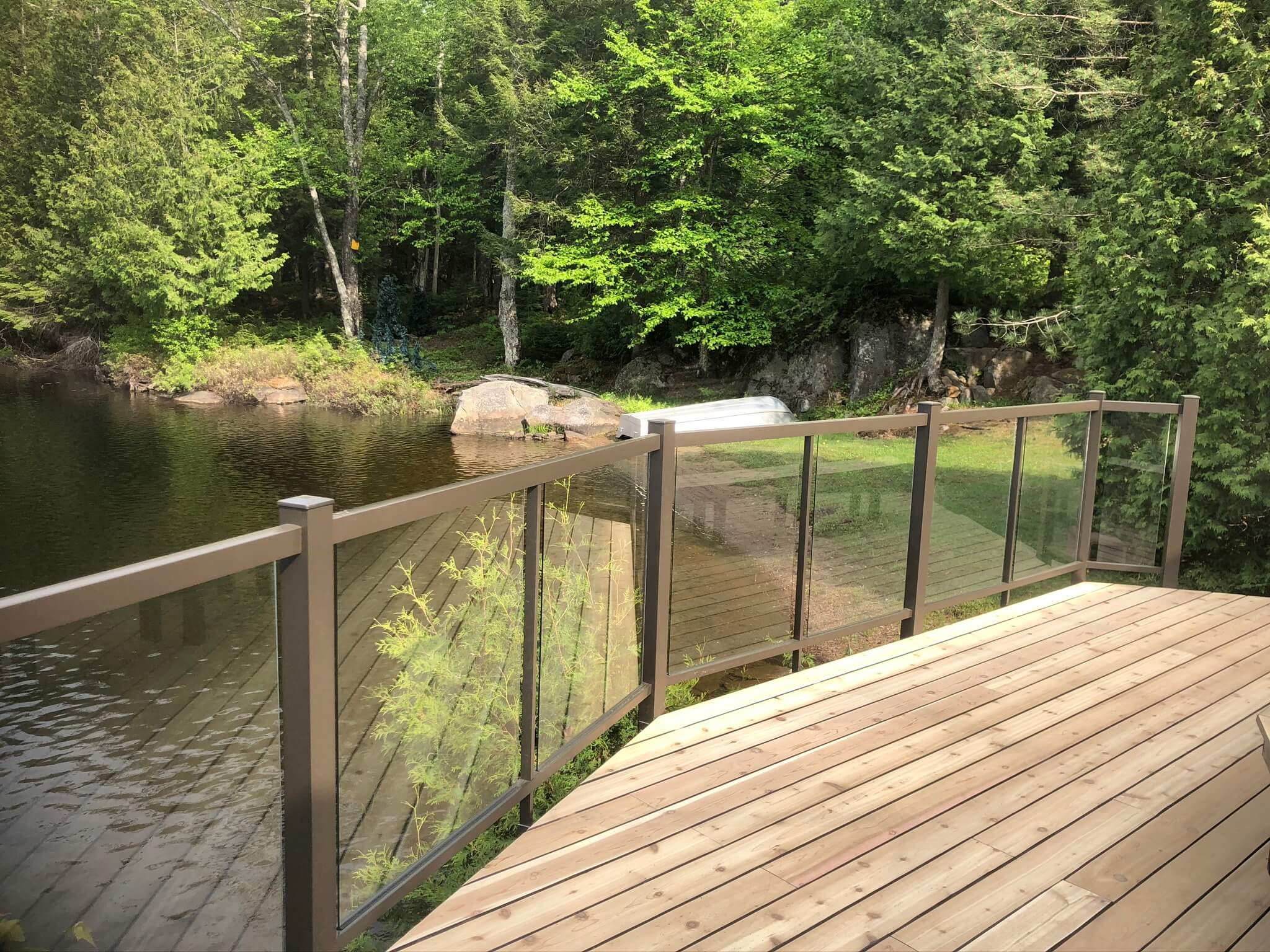 deck with glass railing lake