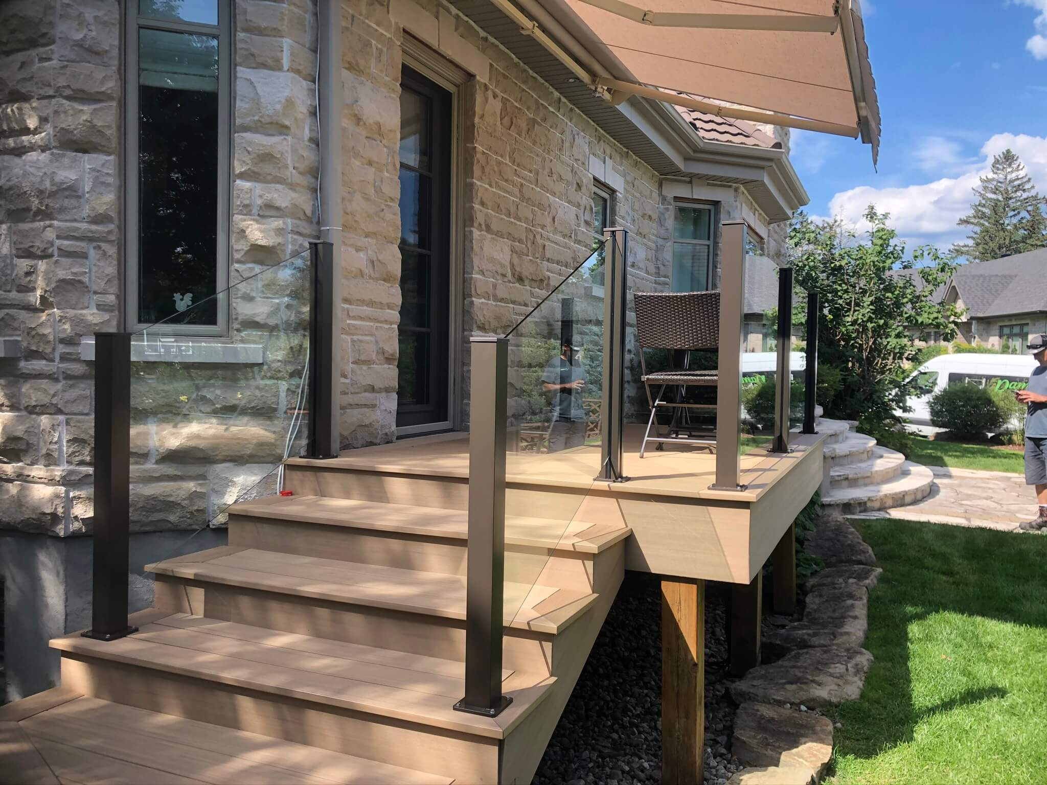 glass railing with brown aluminum posts
