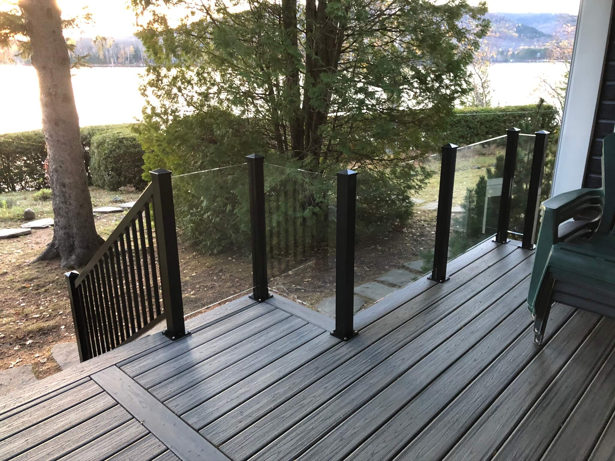 balcony with glass railing and aluminum post