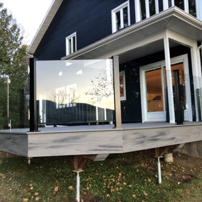 Exterior glass railing with door in Saint-Donat