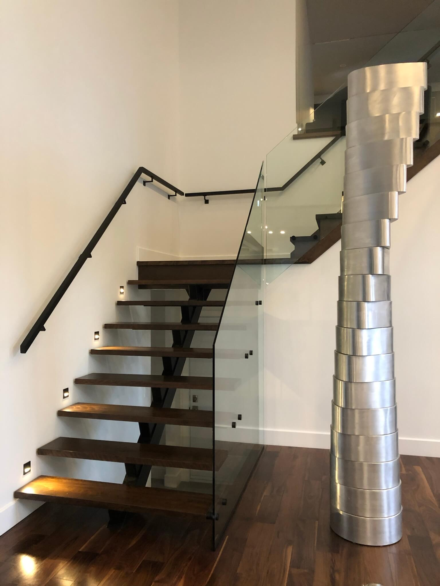 Glass railing staircase with stand-off